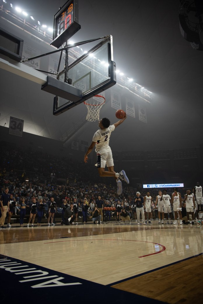 James Bouknight dunks at First Night.  Photo by Charlotte Lao/The Daily Campus