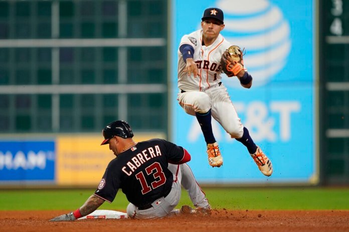Washington Nationals' Asdrubal Cabrera is out at second as Houston Astros' Carlos Correa turns a double play on a ball hit by Ryan Zimmerman during the sixth inning of Game 1 of the baseball World Series Tuesday.  Photo by David J. Phillip/AP