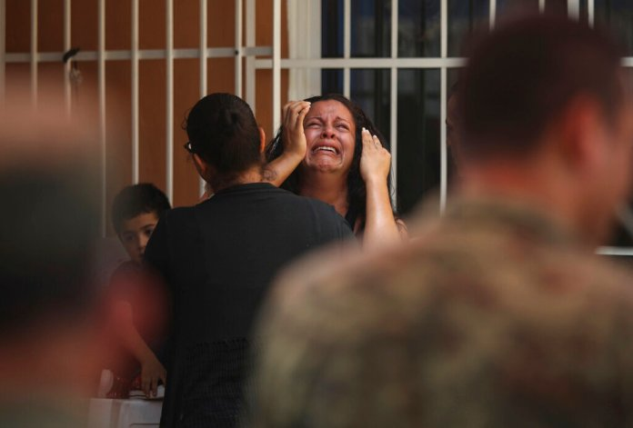 """The mother of Alfredo Gonzalez Munoz a Mexican soldier that died during a massive gun battle in the city of Culiacan between drug cartel gunmen and members of the army and the police, cries during her son's wake in Veracruz, Mexico, Saturday, Oct. 19, 2019. The gunfight in the city of roughly 800,000 residents was triggered Thursday by an attempt to arrest Ovidio Guzman, son of convicted drug lord Joaquin """"El Chapo"""" Guzman Loera, in response to a U.S. request for extradition.  Photos courtesy of AP Photo/Felix Marquez."""