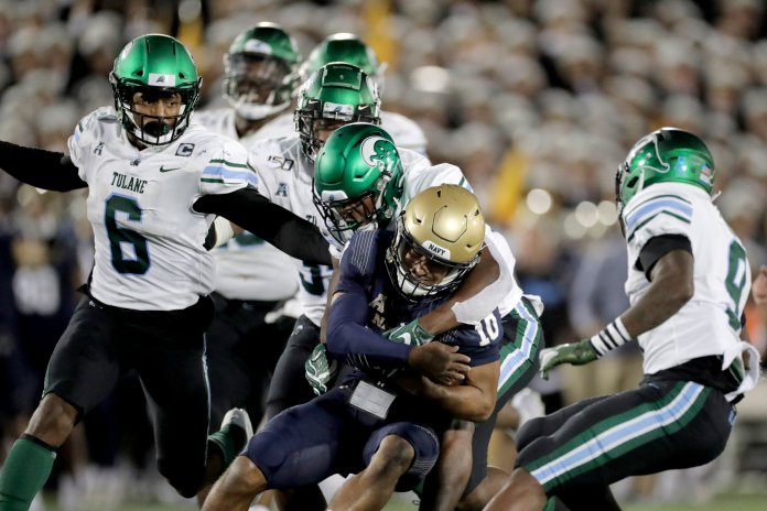 Navy came out on top against Tulane, their offense once again being spearheaded by the run game.  Photo from the Associated Press.