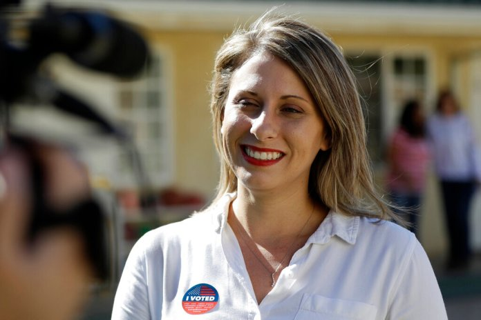 In this Nov. 6, 2018, file photo, Katie Hill speaks during an interview after voting in Agua Dulce, Calif. Hill announced her resignation over the weekend following the publication of explicit photos that outed the relationship.  Photo by Marcio Jose Sanchez/AP