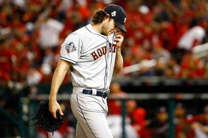 Houston Astros starting pitcher Gerrit Cole walks to the dugout after the third inning of Game 5 of the baseball World Series against the Washington Nationals Sunday, Oct. 27, 2019, in Washington.  Photo by Patrick Semansky/AP
