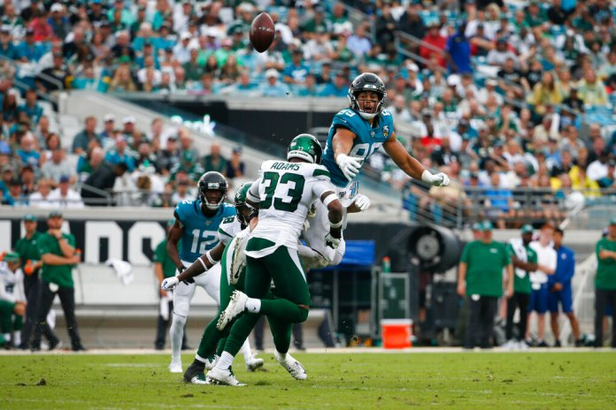 Jacksonville Jaguars tight end Josh Oliver, top right, cannot make a reception as he is hit by New York Jets strong safety Jamal Adams (33) during the first half of an NFL football game, Sunday, Oct. 27, 2019, in Jacksonville, Fla.  Photo by Stephen B. Morton/AP