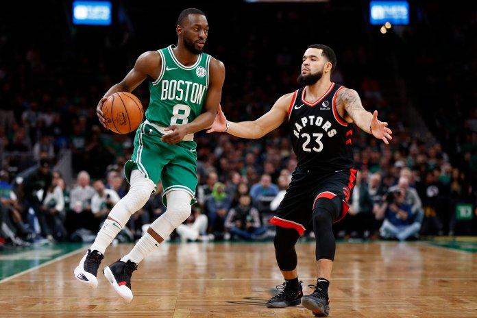 Toronto Raptors' Fred VanVleet (23) defends against Boston Celtics' Kemba Walker (8) during the first half of an NBA basketball game in Boston, Friday, Oct. 25, 2019. (AP Photo/Michael Dwyer)