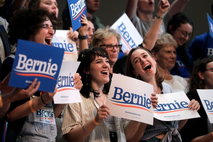 Supporters of Democratic presidential candidate Sen. Bernie Sanders, I-Vt., wave placards, Wednesday, Oct. 30, 2019, during a campaign event in Keene, N.H. In the past few years, young Americans have been  turning  to far-left ideologies that are espoused by such figures as Bernie Sanders and Alexandria Ocasio-Cortez. (AP Photo/Steven Senne)  Thumbnail photo (AP Photo/Mary Altaffer)