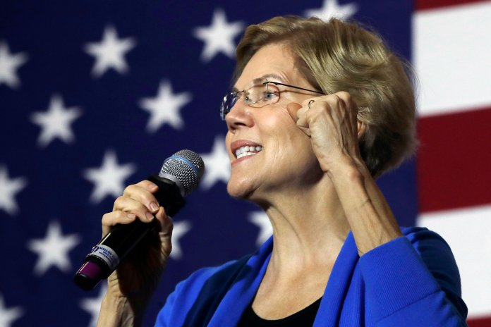 Democratic presidential candidate Elizabeth Warren reveals in her CNN interview that she proposed to her husband Bruce Mann in a UConn Law lecture hall.  AP Photo/Elise Amendola