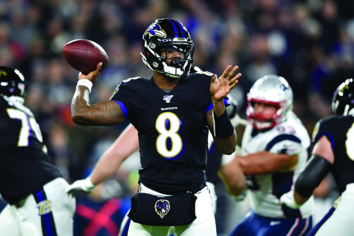 Lamar Jackson torched the otherwise incredible New England Patriots defense on route to handing them their first loss of the year.  Photo from the Associated Press.