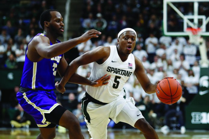 Cassius Winston is leading this year's Spartan squad, and after earning preseason player of the year has high expectations to fulfill.  Photo from the Associated Press.