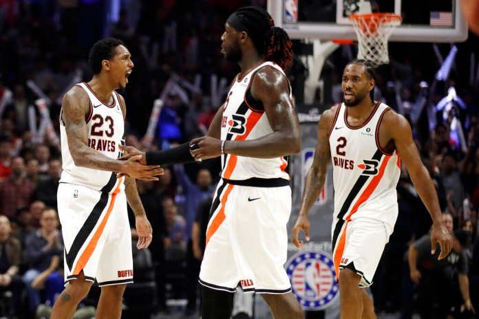 Los Angeles Clippers' Lou Williams (23) celebrates after making a 3-point basket with Montrezl Harrell, center, and Kawhi Leonard (2) during the second half of the team's NBA basketball game against the Portland Trail Blazers on Thursday.  Photo by Marcio Jose Sanchez/AP