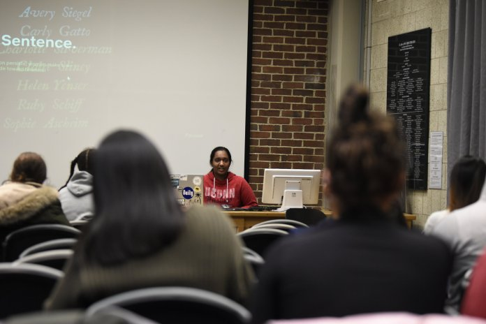 """Anika Veeraraghav, vice president of She's the First, leads a discussion following the showing of a documentary Tuesday night in Homer Babbidge Library. """"Period: End of Sentence,"""" is a documentary that follows the story of Indian women fighting the stigma surrounding menstruation.  Photo by Brandon Barzola / The Daily Campus"""