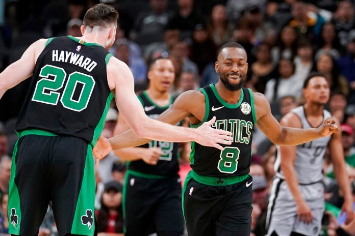 Boston Celtics' Kemba Walker (8) and Gordon Hayward celebrate a basket during the first half of an NBA basketball game against the San Antonio Spurs, Saturday, Nov. 9, 2019.  Photo by Darren Abate/AP