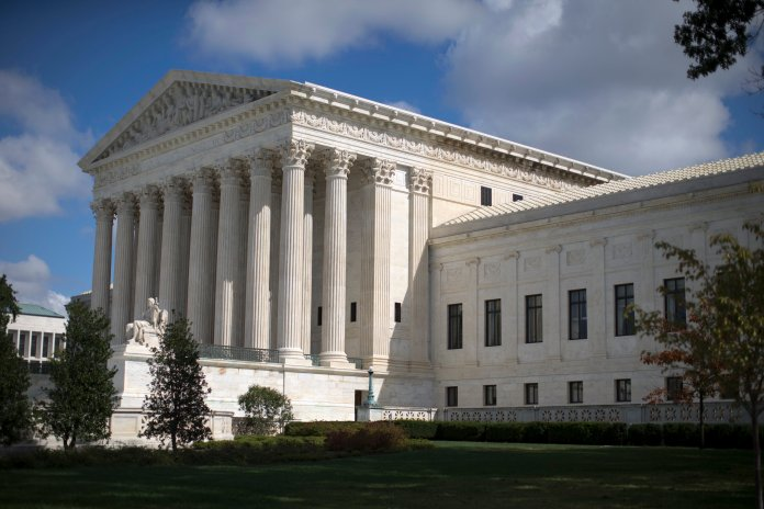 FILE - In this Oct. 5, 2015 file photo, the Supreme Court is seen in Washington. The Supreme Court is letting the lawsuit against the maker of the rifle used in the Sandy Hook Elementary School shooting go forward. (AP Photo/Carolyn Kaster, File)