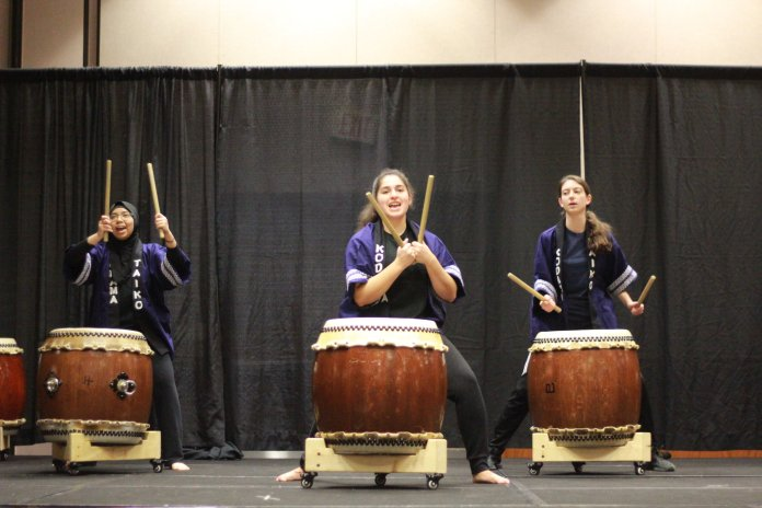 UConn Kodama Taiko, a modern Japanese-style drum group, kicked off the night with a thunderous drum performance.