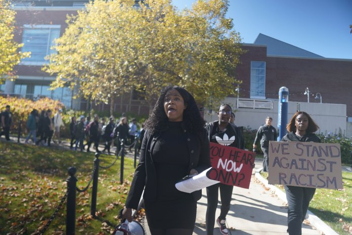In this photo, UConn Students representing the Black Students Association (BSA), the NAACP of UConn, and other student organizations representing Black students took to the center of campus to march Monday, Oct. 21, 2019.  Photo by Eric Wang/The Daily Campus