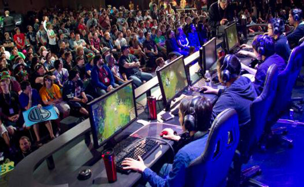 Players compete in a League of Legends championship.  Photo in the    public domain