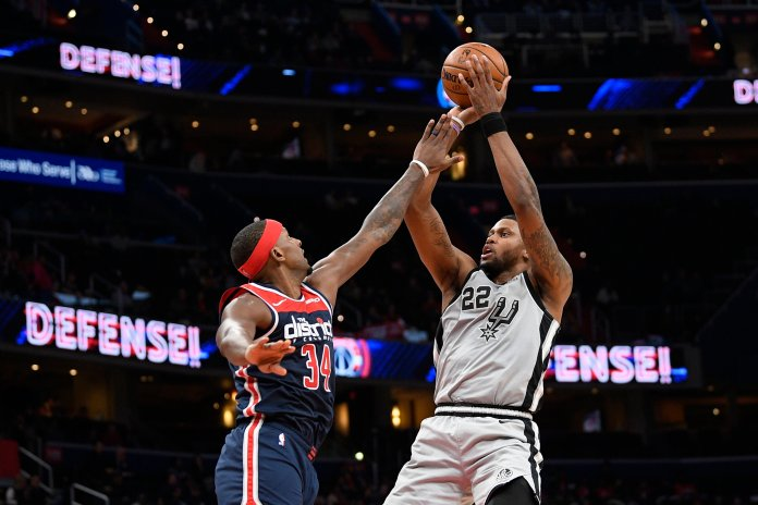 San Antonio Spurs forward Rudy Gay (22) shoots as Washington Wizards guard C.J. Miles (34) defends during the second half of an NBA basketball game Wednesday, Nov. 20, 2019, in Washington. The Wizards won 138-132. (AP Photo/Nick Wass)