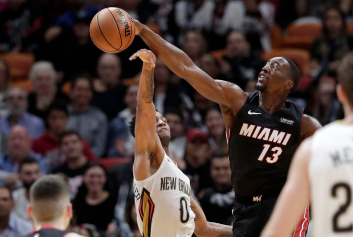 Miami Heat center Bam Adebayo (13) blocks a shot by New Orleans Pelicans guard Nickeil Alexander-Walker (0) during the second half of an NBA basketball game, Saturday, Nov. 16, 2019, in Miami. The Heat won 109-94. (AP Photo/Lynne Sladky)