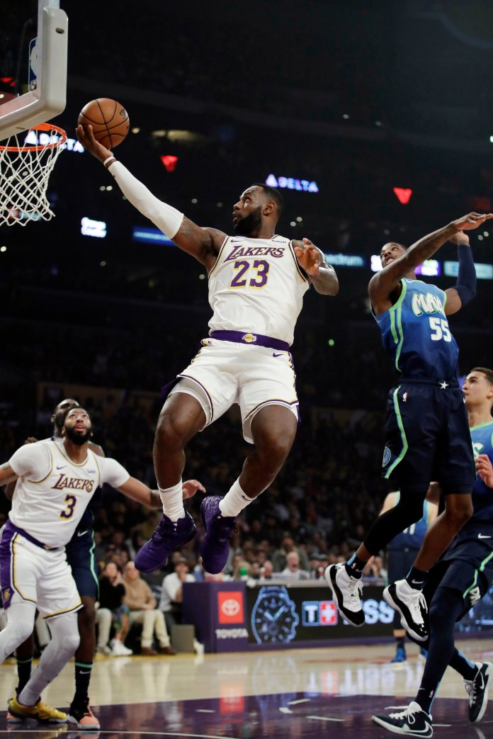 LeBron has been subject to load management for the past several years now, putting to question his status as the GOAT compared to Michael Jordan.  Photo from the Associated Press.