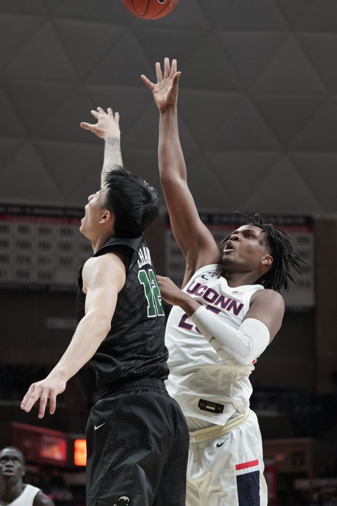 Josh Carlton (25) grabs a rebound from Kevin Zhang (12).