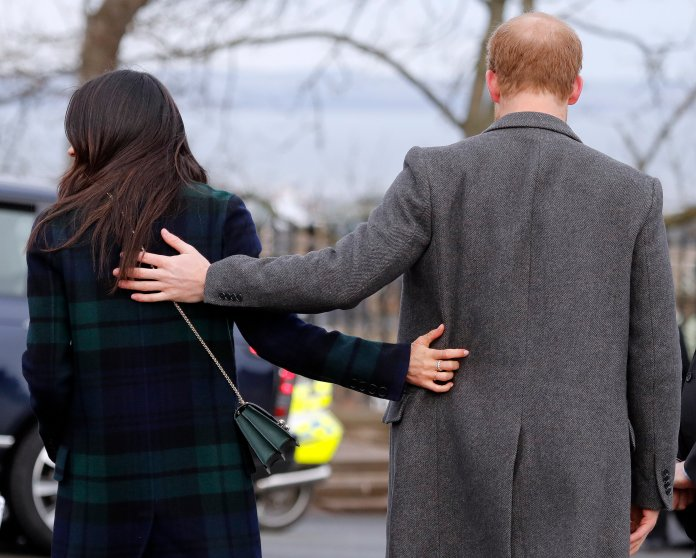 """In this file photo Britain's Prince Harry and his fiancee Meghan Markle arrive at Edinburgh Castle in Edinburgh, Scotland. In a stunning declaration, Britain's Prince Harry and his wife, Meghan, said they are planning """"to step back"""" as senior members of the royal family and """"work to become financially independent."""" A statement issued by the couple Wednesday, Jan. 8, 2020 also said they intend to """"balance"""" their time between the U.K. and North America. (AP Photo/Frank Augstein, File)"""