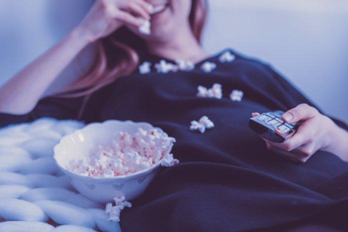 woman-wearing-black-dress-shirt-eating-popcorn-1040159.jpg