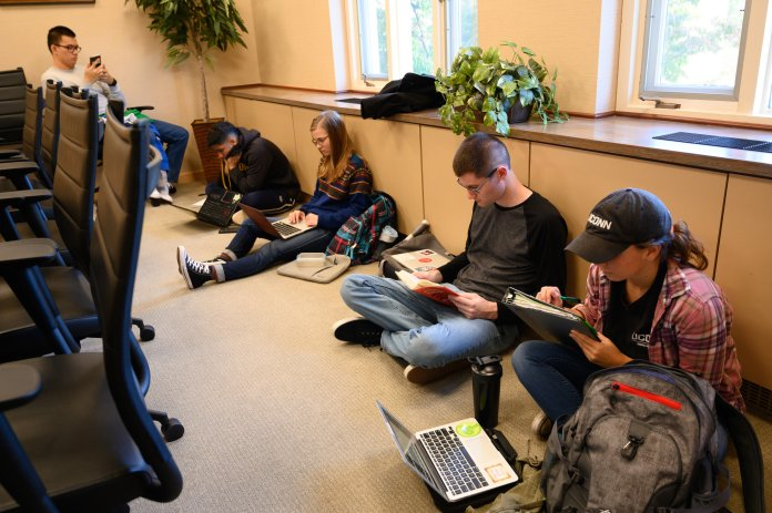 Members of the environmental activism group Fridays For Future stage a sit-in in Gulley Hall for the third week in a row on Friday, Oct. 18. The group will continue the sit-ins until university administration responds adequately to their demands for climate justice.