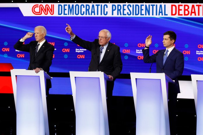 In this Tuesday, Jan. 14, 2020 file photo, from left, Democratic presidential candidate former Vice President Joe Biden, Sen. Bernie Sanders, I-Vt.,and former South Bend Mayor Pete Buttigieg look to answer a question during a Democratic presidential primary debate hosted by CNN and the Des Moines Register in Des Moines, Iowa.   (AP Photo/Patrick Semansky, File)
