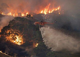 The Australia Wildfires a helicopter tackles a wildfire in East Gippsland, Victoria state, Australia.     State Government of Victoria