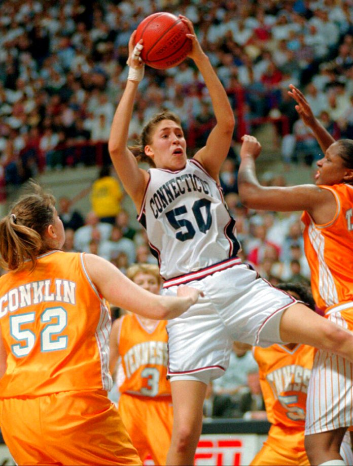 UConn's Rebecca Lobo (50) pulls in a rebound as Tennessee's Abby Conklin (52) and Tiffani Johnson, right, defend during the first half of an NCAA college basketball game in Storrs. For over a decade the rivalry in women's basketball was Tennessee and UConn. After a 13-year absence the two teams will play Thursday night in Hartford, Connecticut.  Photo courtesy of Bob Child/AP Photo