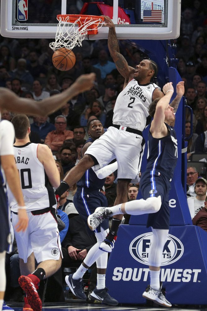 Los Angeles Clippers forward Kawhi Leonard dunks the ball over Dallas Mavericks forward Luka Doncic in during the first half of an NBA basketball game Tuesday in Dallas. Despite missing time for load management, Leonard is well on his way to his fourth All-Star appearance.  Photo courtesy of Richard W. Rodriguez/AP Photo