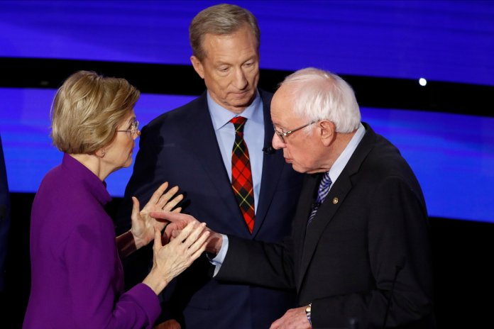 In this Jan. 14, 2020, file photo, Democratic presidential candidate Sen. Elizabeth Warren, D-Mass., left and Sen. Bernie Sanders, I-Vt. after a Democratic presidential primary debate hosted by CNN and the Des Moines Register in Des Moines, Iowa. (AP Photo/Patrick Semansky, File)