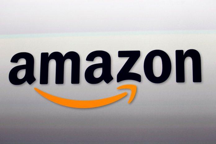 This Sept. 6, 2012, file photo shows the Amazon logo in Santa Monica, Calif. (AP Photo/Reed Saxon, File)