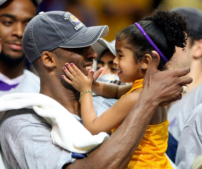 Beyond the court, Kobe was a beloved husband, son and father of four daughters, one named Gianna who was also in the helicopter when it crashed.  Photo courtesy of The Associated Press.