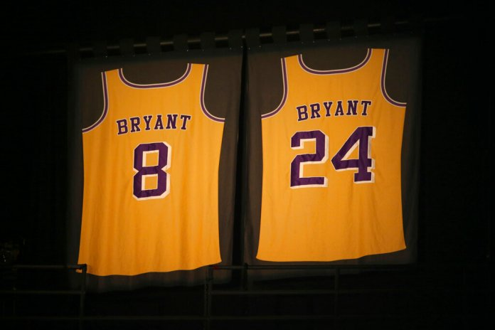 Los Angeles Lakers jersey numbers belonging to retired NBA player Kobe Bryant hang inside Staples Center prior to the start of the 62nd annual Grammy Awards on Sunday, in Los Angeles.  Photo courtesy of Matt Sayles/Invision via AP