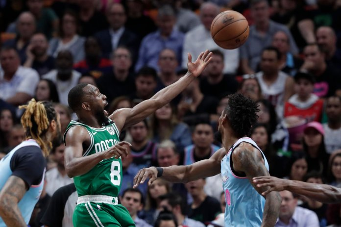 Boston Celtics guard Kemba Walker (8) goes to the basket past Miami Heat forward Chris Silva,right, during the first half of an NBA basketball game, Tuesday, Jan. 28, 2020, in Miami. (AP Photo/Lynne Sladky)