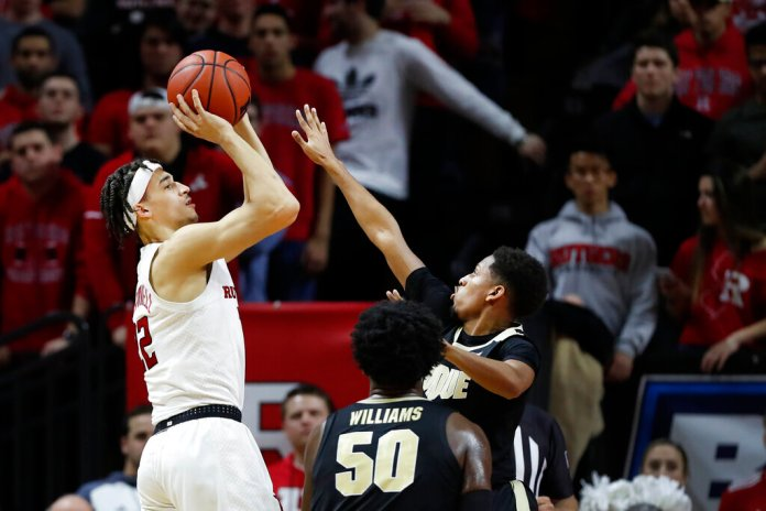 Rutgers guard Caleb McConnell (22) shoots a 3-pointer as Purdue guard Isaiah Thompson (11) defends during the first half of an NCAA college basketball game Tuesday in Piscataway, N.J.  Photo courtesy of Kathy Willens/AP Photo