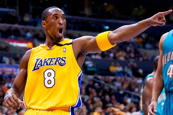 Former Los Angeles Lakers' Kobe Bryant points to a teammate during an NBA basketball game in Los Angeles. Bryant passed away Sunday in a helicopter crash with eight other people, including his 13-year old daughter Gianna.  Photo by Mark J. Terrill/AP Photo