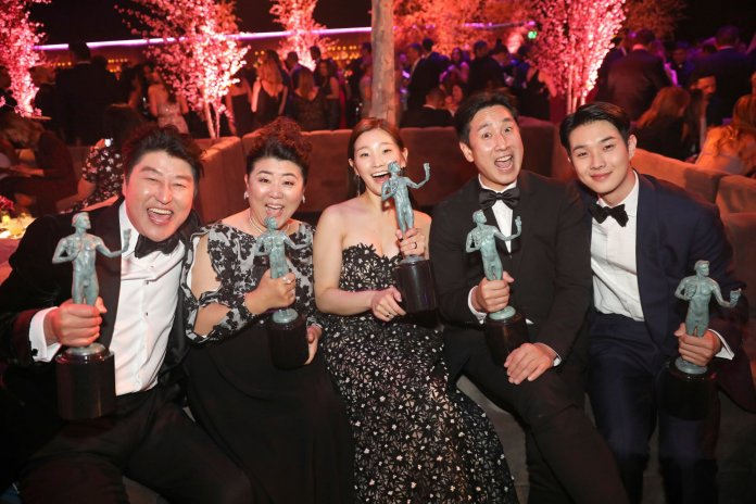 """Kang-Ho Song, from left, Jang Hye-jin, Park So-dam, Lee Sun Gyun, and Choi Woo-shik, winners of the award for outstanding performance by a cast in a motion picture for """"Parasite"""" attend the 2020 PEOPLE SAG Awards Afterparty at the Shrine Auditorium & Expo Hall on Sunday, Jan. 19, 2020, in Los Angeles. (Photo by Colin Young-Wolf/Invision for PEOPLE Magazine/AP Images)"""