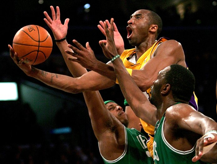 Former Los Angeles Lakers' Kobe Bryant goes up for a shot between the Boston Celtics' Paul Pierce, and Al Jefferson during the first half of an NBA basketball game in Los Angeles. Bryant was known for his work ethic and determination.  Photo courtesy of Branimir Kvartuc/AP Photo