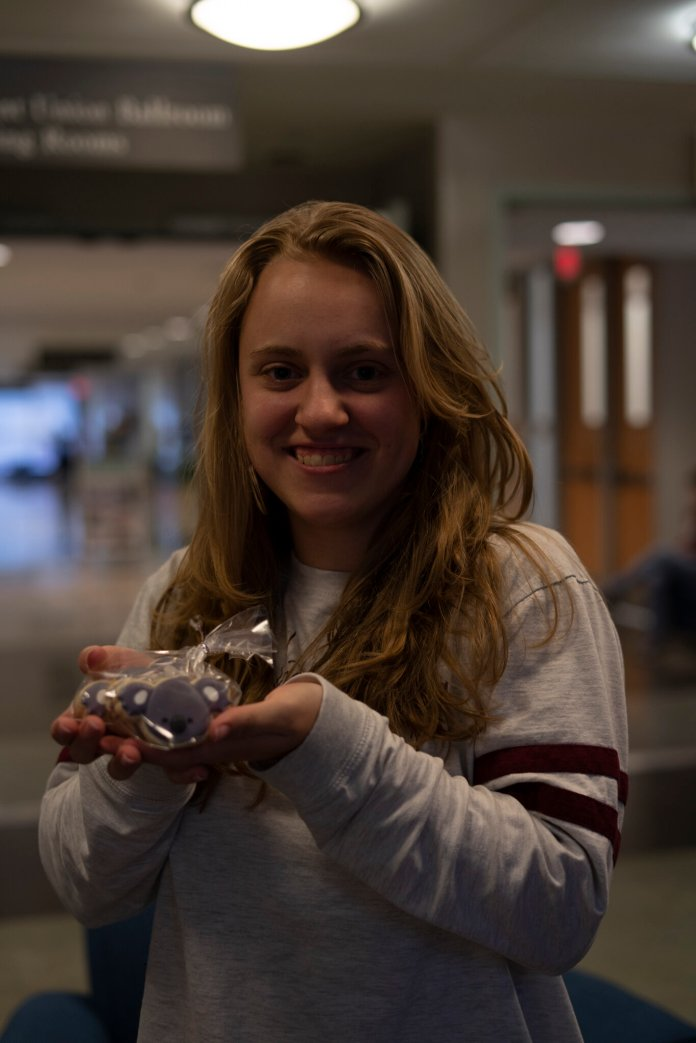 UConn student Liv Shoenbeck sells koala-shaped cookies in the Student Union to raise money for animals effected by the Australian bushfires.   Photo by Maggie Chafouleas/The Daily Campus