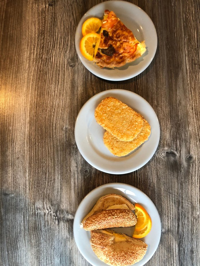 A photo of breakfast quiche, hash browns, and an egg sandwich. This week the brunch location of choice was the Spring Hill Cafe. The Daily Campus / Olivia Hickey