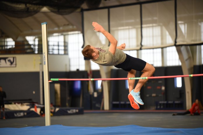 The UConn men's track and field team hosted a heptathlon in Hugh S. Greer Field House. A UConn men's track athlete jumps over a beam in practice.  Photo by Charlotte Lao, Photo Editor/The Daily Campus