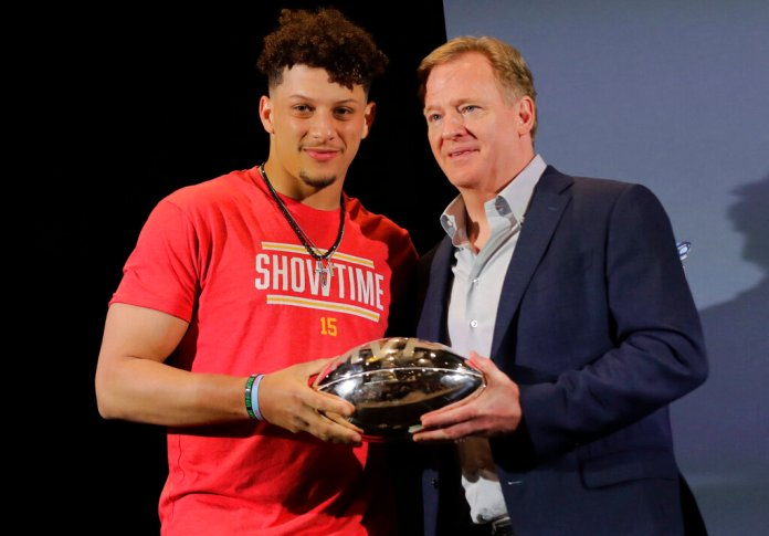 Kansas City Chiefs quarterback Patrick Mahomes, left, holds the MVP trophy with NFL Commissioner Roger Goodell before speaking at a press conference Monday in Miami.  Photo courtesy of Brynn Anderson/AP Photo