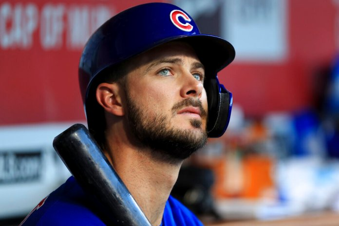 Chicago Cubs' Kris Bryant sits in the dugout during a baseball game against the Cincinnati Reds in Cincinnati. The All-Star third baseman has lost his service-time grievance against the Cubs and will have to wait two years before reaching free agency.  Photo courtesy of Aaron Doster/AP Photo