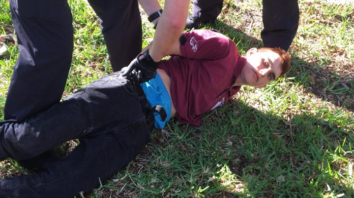 Police photo of Nikolas J. Cruz being arrested by police in Florida, February 14, 2018. This is the Parkland Shooter who got into the jail altercation. Photo from  WikiCommons .