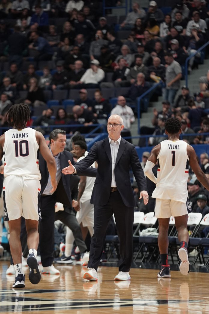 UConn lost to Tulsa Sunday and they will play them this upcoming Thursday. Head coach Dan Hurley extends his hand to hi-five Brendan Adams during a game against Tulsa.  Photo by Eric Wang/The Daily Campus