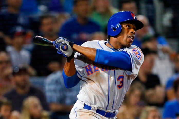 In this April 22, 2016, file photo, New York Mets' Curtis Granderson (3) follows through for a solo home run in the fourth inning of a baseball game against the Atlanta Braves in Atlanta.   Photo by John Bazemore/AP