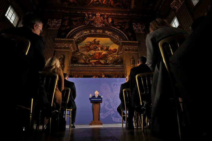 British Prime Minister Boris Johnson outlines his government's negotiating stance with the European Union after Brexit, during a key speech at the Old Naval College in Greenwich, London, Monday, Feb. 3, 2020. (AP Photo/Frank Augstein)