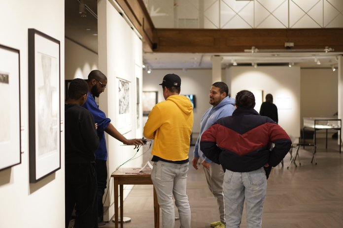 The Benton Museum hosts exciting events around the Beanery and the gallery every first Thursday of the month. Activities include live acoustic music, crafts, therapy dogs, and scavenger hunts.  Photo by Eric Wang/The Daily Campus