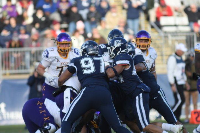 The Huskies lost against ECU after a close game with a final score of 24-31. The team closes the season with a record of 2-10 overall.  Photo by Eric Wang by The Daily Campus